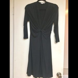 Black cocktail dress; 40 inches long.